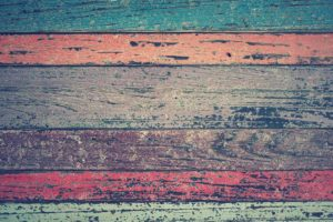 picture of wood panels in different colors (turquoise, orange, gray, brown, pink, green)