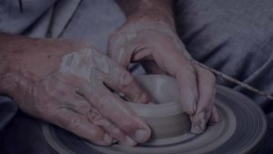 picture of hands creating ceramic pottery