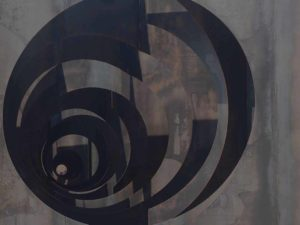 Picture of large scale sculpture of circles creating visual maze