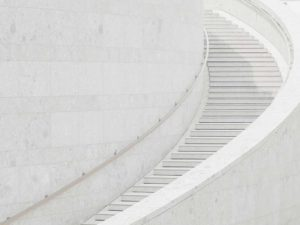 picture of white curved outside stairs