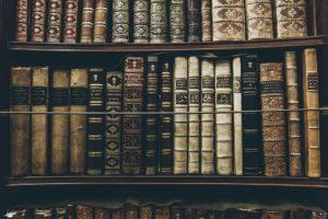 picture of older books on bookshelf