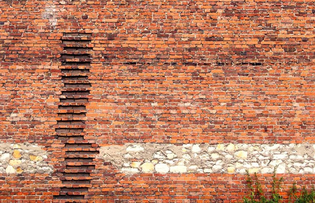 picture of brick wall will pieces missing