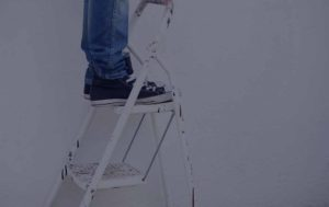 picture of person on stepstool